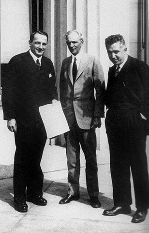 Ford-contract for Gorky Automobile Plant signed in Dearborn, Mich., May 31, 1929. Left to right-Valery I. Mezhlauk, Henry Ford, Saul G. Bron