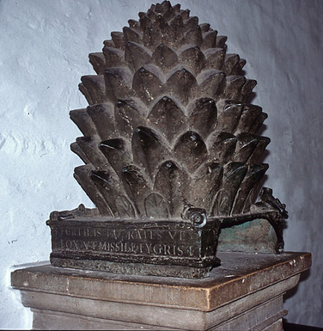 Bronze pine cone in the narthex of the cathedral at Aachen. This bronze sculpture may have been brought to Aachen from Italy at the time of Charlemagne, or it may have been cast in Germany as late as ca. 1000. It was inspired by the pine cone that once stood in the courtyard of Old St. Peter's Basilica and is now in the Cortile della pigna of the Vatican Museums.
