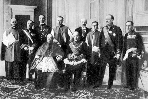 Cardinal Gasparri and Benito Mussolini (seated) after exchanging treaty ratifications in the Hall of Congregations, the Vatican, June 7th 1929