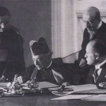 Cardinal Gasparri signs Lateran Concordat as Mussolini looks on