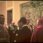 Hitler at New Year's reception in the Chancellery-right with back to camera, Vatican minister Orsenigo