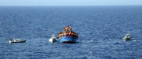 Boat overcrowded with migrants in the Mediterranean Sea. The boat was carrying nearly 600 people, and the remaining 566 survivors were rescued by the navy frigate Grecale and were headed to the port at Pozzallo, on the southern tip of Sicily. (Photo: Italian Navy, 2014-06-29)