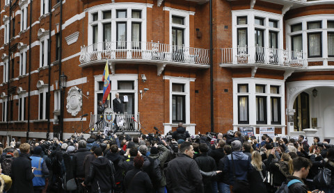Wikileaks founder Julian Assange speaks on the balcony of the Ecuadorean Embassy in London, Friday, Feb. 5, 2016. (AP Photo/Kirsty Wigglesworth)