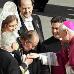 King Juan Carlos of Spain kissing the hand of Bishop James Harvey