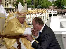 Spain's King Juan Carlos kisses the hand of Pope John Paul II  during a ceremony attended by hundreds of thousands of people in Madrid's central Plaza de Colon square 04 May 2003 on the second day of the Pope's visit to Madrid.