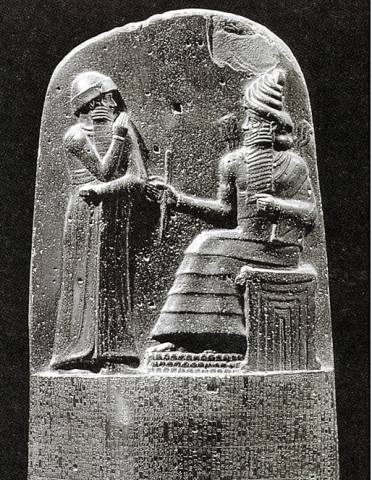 "Law Code Stele of Hammurabi, king stands before the throne of the sun god (god of great ""light"", Shamash)"