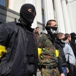 Members of the Ukrainian far-right radical group Right Sector stand outside the parliament in Kiev, Ukraine, 2014-03-28