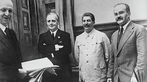 Soviet Commissar for Foreign Affairs Vyacheslav Mikhailovich Molotov, far right, General Secretary of the Communist Party Josef Stalin, second from right, and German Reich Foreign Minister Joachim von Ribbentrop, third from right, pose together after signing the German-Soviet non-aggression pact in Moscow, August 23, 1939, AP Photo