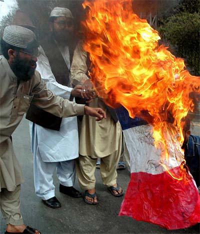 Muslims residing in France burn the flag of their adopted nation, France 2012