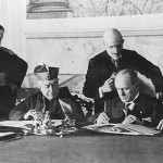 Mussolini signs the Lateran Pact of 1929, which brought into being the Vatican City State