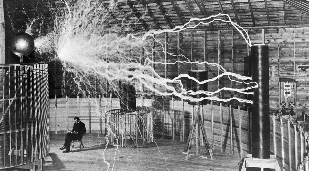 Nikola_Tesla,_with_his_equipment_Wellcome-opt