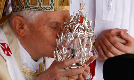 Pope Benedict XVI. kisses the glass reliquary containing blood of the late Pope John Paul