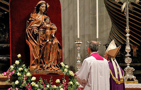 Pope Francis prays before a statue of Mary in St. Peters Basilica on Nov 30 2013