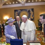 Queen Elizabeth II and Prince Philip, the Duke of Edinburgh, exchange gifts during an audience with His Holiness, Pope Francis, in the Pope's study during their one-day visit to Rome on April 3, 2014 in Vatican