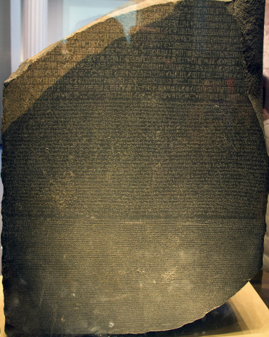 Dating from 196 BC, the Rosetta Stone was carved in honour of Pharaoh Ptolemy V and his ancestors. The text as such was composed so that three different segments of the population could read it: in hieroglyphics for the priests, in a derived demotic script for everyday purposes, and in Greek for the then rulers of Egypt. Since the Stone was indispensable when it came to deciphering the hieroglyphic code, it is now seen as early testimony to the work of translators.