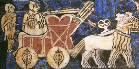 "Dvanáctá planeta, obr. 19: Wheel, invented sometime before the 4th millennium BC, is one of the most ubiquitous and important technologies. This detail of the ""Standard of Ur"", ca. 2500 BC., displays a Sumerian chariot"