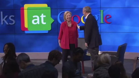 "Google Is Not What It Seems: Google Chairman Eric Schmidt shares a joke with Hillary Clinton during a special ""fireside chat"" with Google staff. The talk was held on 21 Jul 2014 at Google's headquarters in Mountain View, California"