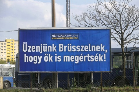 """We send a message to Brussels, so that they understand it too,"" says the government-sponsored billboard"