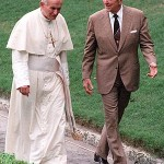 Pope John Paul II, left, walks with President Ronald Reagan in the garden of the Vizcaya, a lavish mansion on Biscayne Bay, Thursday, Sept. 10, 1987, in Miami. The CIA worked closely with Pope John Paul II to hasten the fall of communism in Poland, according to a new book co-written by Watergate reporter Carl Bernstein. As part of the informal alliance, the book claims, President Reagan cut off funding for abortion programs overseas, and the pope kept silent on U.S. efforts to install cruise missiles in Western Europe. (AP Photo/Scott Stewart)