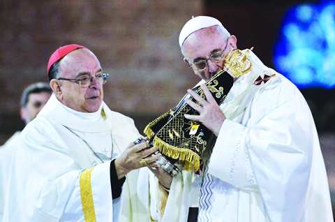 Pope kiss stone and wood and call it holy